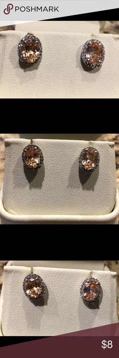 Earrings, studs. Yellow stone Earrings, beautiful stone with cubic zirconia stones surrounding the center stone. These were a Christmas gift, but I'm allergic to any metal except 14K gold. Jewelry Earrings