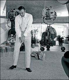 "Connery practicing his golf stance between scenes in Las Vegas for ""Diamonds Are Forever"" Photo part of the ""A Day Out With Sean Connery"" collection by Terry O'Neill. James Bond Actors, Film Facts, Bond Issue, Terry O Neill, Golf Stance, Modern Games, Sean Connery, On Set, Diamonds"