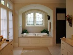 I just love tubs in front of windows. The arch just goes above and beyond.