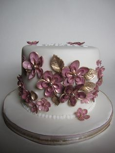 https://flic.kr/p/8oeBt9 | Pink & gold birthday cake | Birthday cake for my sister - vanilla sponge with raspberry buttercream filling.  Flowers and leaves painted with rose gold lustre.  Inspired by all the gorgeous creations from Small Things Iced!