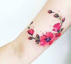 Watercolor tattoo style of Flowers motive done by artist Pissaro Tattoo