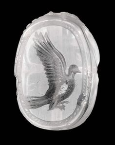 A dove flying to left. Overall: 2.3 x 1.6 x 1.4 cm (7/8 x 5/8 x 9/16 in.)  Provenance By date unknown: Count Michel Tyszkiewicz Collection; 1898:  East Greek, Late Classical Period, Scaraboid intaglio with dove   MFA for Educators