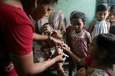 Vaccination Mission    Professional Category: Winner Goal 4    Piyal Adhikary, India    Radha Das, a social health activist, applies the Hepatitis B vaccine to a child at a rural health centre in India.