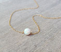 This delicate, understated opal gold necklace is sure to be your new go-to everyday piece. A stunning yet simple necklace features a dainty 14K gold filled chain and a single ball opal charm. This gold necklace brings just a hint of sophistication to any look, yet it subtle and versatile