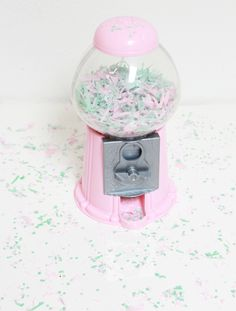 Fun idea -- paint an old gumball machine and fill with confetti.  A Bubbly Life: Ice Cream Birthday Party