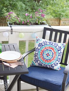 Outdoor living calls for saturated colors and soft lights for evening patio dining.