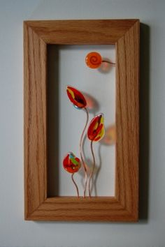 ORIGINAL Wall Sculpture Colorful Glass Flowers on Copper Stems Wood Frame. By Robyn and Steven Lince, via Etsy.