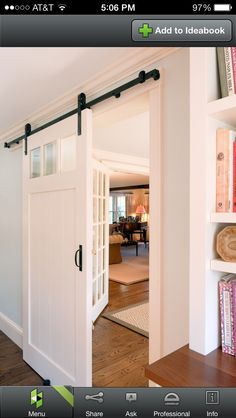 barn door for laundry room.  perfect with the windows just above to let light in but hide the mess