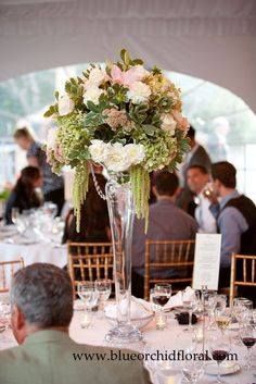 Tall centerpiece in soft greens, pinks, and whites - Dahlias, Garden/Spray Roses, Sedum, Stock, green Hanging Amaranthus tassels, and crystal garlands - by Heather Murdock of The Blue Orchid