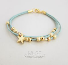 Leather Charm Bracelet - Gold Star Charm Bracelet, Layered Bracelet, Gold Bar Bracelet, Stardust Beads, Pastel Blue Cord Bracelet - Stardust. $23.00, via Etsy.