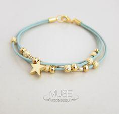 Leather Charm Bracelet - Gold Star Charm Bracelet, Layered Bracelet, Gold Bar Bracelet, Stardust Beads, Pastel Blue Cord Bracelet - Stardust. $23.00, via Etsy.