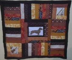 Molly's quilt. Cross stitched dachshund and patchwork.
