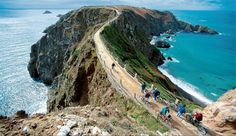 Isle of Sark - Channel Islands.  This isthmus is called the Le Coupee.  Biking across it was a challenge!