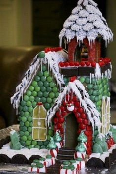 Gingerbread house covered in assorted candy. Love the roof!