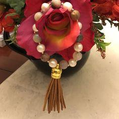 Pearl and bead stretch bracelet Trending Pearl and bead bracelet w/ suede tassel . So much fun . Handmade Jewelry Bracelets