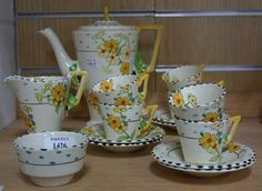 A Burleigh Ware 'Golden Days' Art Deco coffee service of angular design decorated with yellow flowers and green and black spots, comprising a coffee pot and cover, six cups and saucers, a cream jug and sugar bowl, pattern Tooveys. Art Deco, Art Nouveau, Vintage Teapots, Coffee Service, Golden Days, The Saleroom, Coffee Set, Black Spot, Yellow Flowers