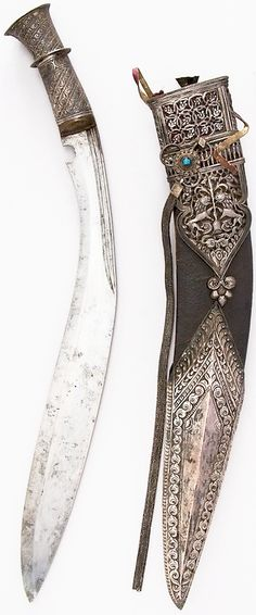 Kukri (19th Century Nepalese Weapon) | Steel, silver, wood, leather, Knife (a); H. with sheath 18 1/16 in. (45.9 cm); H. without sheath 16 13/16 in. (42.7 cm); W. 1 11/16 in. (4.3 cm); Wt. 16.6 oz. (470.6 g); sheath (b); Wt. 9.5 oz. (269.3 g); small knife (c); H. 4 9/16 in. (11.6 cm); W. 7/8 in. (2.2 cm); Wt. 0.8 oz. (22.7 cm); small knife (d); H. 4 1/2 in. (11.4 cm); W. 15/16 in. (2.4 cm); Wt. 1.2 oz. (34 g)