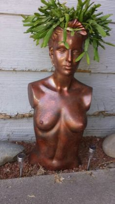 Rhipsalis in old mannequin painted like copper.
