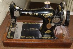 Singer sewing machine . . my maternal grandmother had one like this . . .they always remind me of her