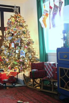 This is one amazing Christmas home tour - she decorates with memories! No color coordinating here - she uses family mementos in her Christmas decorations!