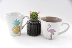Dollar store hack: Make your own personalized tropical mugs.  DIY mugs, tropic DIY, tropical DIY, flamingo mug, flamingo DIY mug, pineapple mug, pineapple DIY mug, tropical DIY mugs, Personalized coffee mugs, DIY painted mugs, DIY mugs designs, DIY mugs gifts, DIY mugs for mom, DIY mugs tutorial. #diy #tropicaldiy #mugdiy Tropical Mugs, Tropical Design, Diy Mugs, Personalized Coffee Mugs, Dollar Store Hacks, Dollar Stores, Diy Mug Designs, Painted Mugs, Diy Painting
