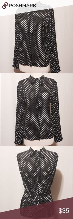 """⭐️ Navy and white polkadot tie neck blouse Act like a lady! Vintage navy & white tie neck button down with hidden placket, long sleeves. 100% poly Machine washable. 42"""" bust 16.5"""" shoulder 25"""" sleeve length 25"""" overall length impeccable condition josephine chaus Tops Button Down Shirts"""