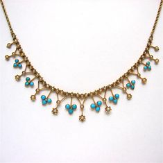 A VICTORIAN HALF PEARL AND TURQUOISE NECKLACE