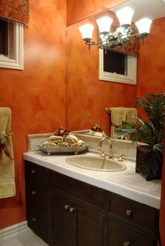 Orange bathroom with gold faucets, dark wood cabinetry and tile countertops. You can make your own bathroom vanity from an old dresser, just as these homeowners did. See how by clicking on the image. Orange Bathroom Decor, Orange Bathrooms, Brown Bathroom, Bath Decor, Small Bathroom, Master Bathroom, Bathroom Ideas, Bath Ideas, Diy Bathroom Remodel