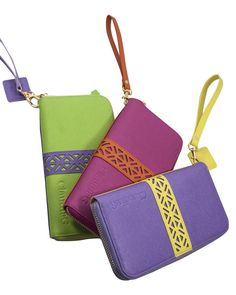 """p {max-width: 80%;}    Organize your purse with our new zippered closure leather wallet. This style features 10 card slots, two  cash compartments, and a central pocket to even fit your phone. Perfect as a gift.    Color: Watermelon/Orange      Genuine leather    HxL: 4.5"""" x 8""""     Removable strap 6""""     Purple and Canary yellow leather  interior lining      Inside divisions       2 cash compartments     12 card pockets     Zippered back pocket      Zippered closure     Embossed ClaudiaG…"""