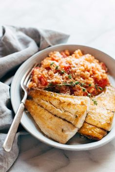 Creamy Tomato Risotto with Pan Fried Barramundi! Slow-simmered tomato parmesan risotto paired with crispy fish. YUM! | pinchofyum.com