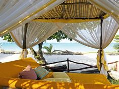 Seaside Canopied Bed. Outdoor Room Inspiration from Luxury Resorts >> http://www.hgtv.com/outdoor-rooms/diy-outdoor-projects-inspired-by-boutique-hotels/pictures/index.html?soc=pinterest