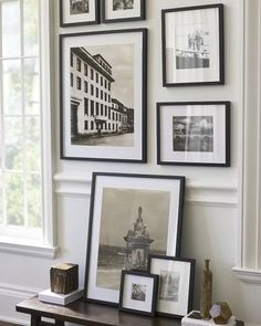 Continue your framed photographs, etchings and other black and white images from the  wall to table for interest and unity.  Black frames and white mats for a more subtle display. Use mixed frame styles and mat colors for something that is Bohemian.