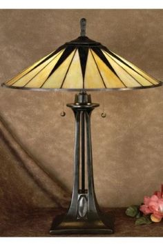 With an Art Deco appeal, the Quoizel Gotham Tiffany Lamp has a refined silhouette and clean design. Featuring a two-tone Tiffany glass. Tiffany Stained Glass, Lamp, Beautiful Lamp, Tiffany Glass, Tiffany Table Lamps, Stained Glass Lamp Shades, Art Deco Lamps, Glass, Stained Glass Lamps