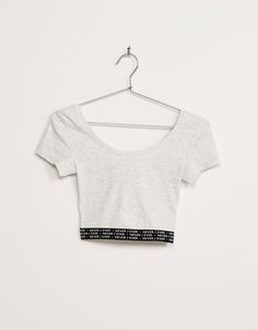 BSK cropped elastic band top with text. Discover this and many more items in Bershka with new products every week