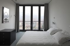 Marvelous Four Glass Floor To Ceiling Windows With Sliding Curtains As Well As White Master Platform Bed Set In Small Space Master Bedroom Decors Bedroom Decor Dark, Small Bedroom Interior, Bedroom Decor For Teen Girls, Home Interior Design, Master Bedroom, Floor To Ceiling Curtains, Sliding Curtains, Window Curtains, Platform Bed Sets