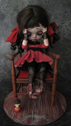 Lonely? Sad? BJD Doll in red dress.