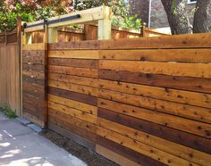 wood fence with sliding gate