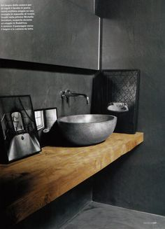 Lindo banheiro cinza, com concreto e alumínio/ recycled aluminum cast vessel sink set atop rough sawn lumber provides a good balance with the gray concrete in the rest of this bathroom. These sinks and reclaimed slabs of wood are available from Eco-Friendly Flooring in Wisconsin.