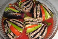 Yelpaze Kebabı 5 pieces of eggplant For filling; 1 clove garlic 1 small size protects grated onion Salt, black pepper, red pepper flakes A little parsley 1 seed tomatoes 2 green pepper grains For the above; Eggplant Dishes, Meat Recipes, Cooking Recipes, Fresh Fruits And Vegetables, Middle Eastern Recipes, Turkish Recipes, Stuffed Green Peppers, International Recipes, Chile Relleno