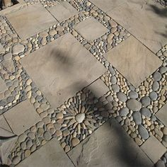 DIY - gravel and square pavers . . . fairly easy and quick way to get extended patio or walkway area.