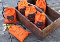 DIY stamped bags for Halloween: cut apple in half and carve into Jack-O-Lantern face, let dry for 30 min, then coat in craft paint and stamp onto bags.  Write message with   Sharpie.  {Pottery Barn Kids}