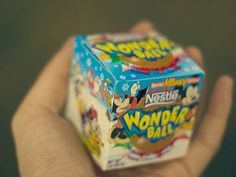 Wonder Ball was a spherical chocolate ball with a toy inside. Nestle stopped manufacturing them in 1997 after some children chocked on the toys.  oh a childhood fave that i somehow completely forgotten.
