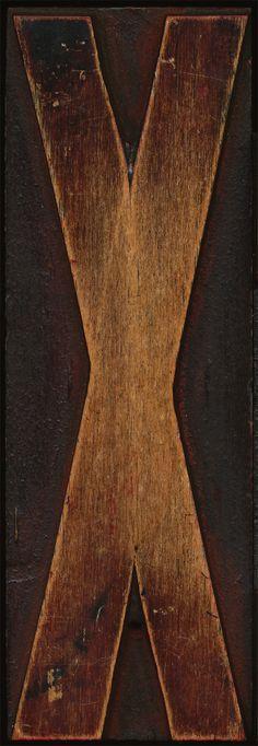 Wooden raised printing block with condensed cap X