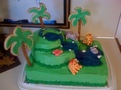 Jungle themed baby shower cake. completely edible with fondant animals and sugar cookie+pretzel rod palm trees
