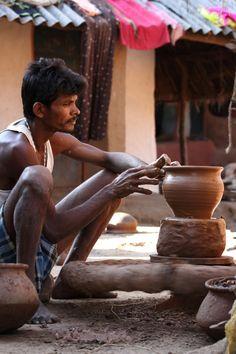Clay-Potter at work, from Gadaba tribe, Orissa [New Name: Odisha], India