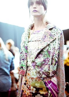 Mary Katrantzou SS'12. love the studded sleeves against the florals.