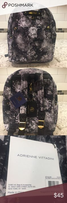 NWT Adrienne vittadini black/white floral backpack Standout black and white floral print nylon and leather embellished backpack NWT fully lined with lots of organization pockets in and out. Adrienne Vittadini Bags Backpacks