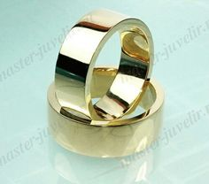 Классические широкие обручальные кольца, толщина 2 мм. Изготовлены на заказ. Артикул Обр1041, золото 750 пробы, вес 17 гр/кольцо, ширина 8 мм.