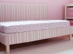 Upholstered Toddler Daybed ~ Reading spot by day, comfortable padded bed by night. Repurpose a standard crib mattress & bedding to create your own upholstered toddler daybed with simple tools & no sewing.