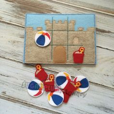 This felt tic-tac-toe game set has bucket and beach ball pieces. Its perfect for little children! Theres even a built in pocket on the back for